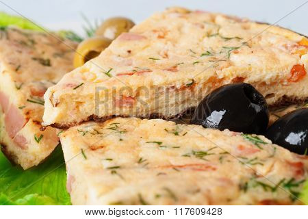 Slices Of Omelette With Olives Close