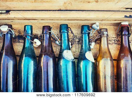 Vintage Bottles on Wooden Background