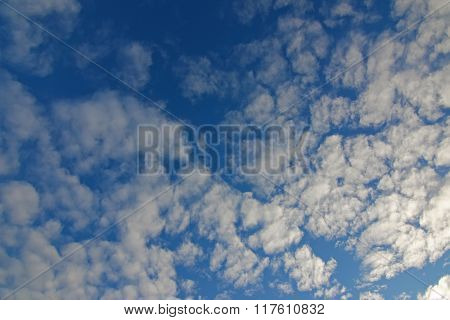 Background photo of natural Cirrocumulus Clouds formation on a blue sky during winter in Europe