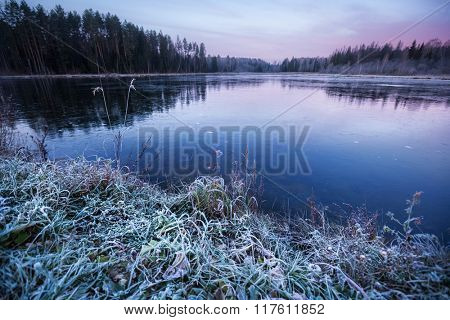 First thin ice on the lake at sunrise