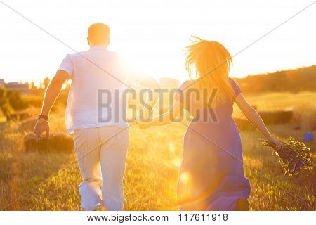Silhouette of couple on sunset