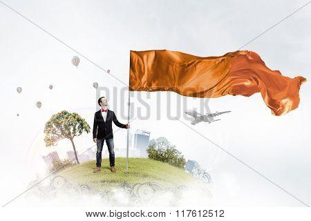 Man with orange waving flag