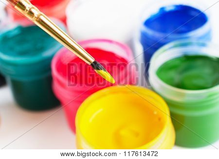 Brush And Many Paint Jars With Colored Gouache