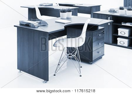 wooden desks and white plastic armchairs in the office