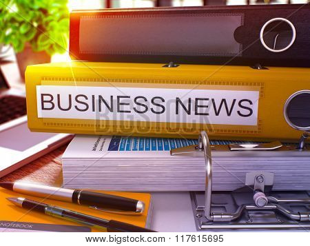 Yellow Office Folder with Inscription Business News