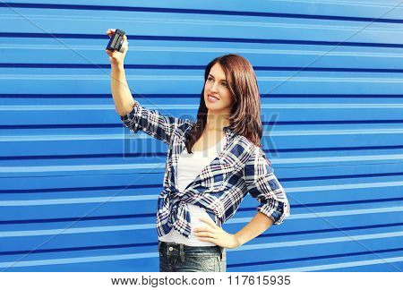 Pretty Young Woman Makes Self-portrait On Camera In City