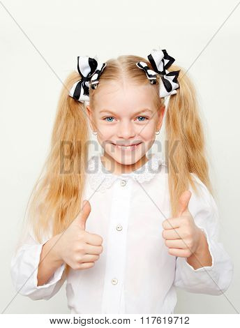 Smiling Girl Showing Thumbs Up Symbol.