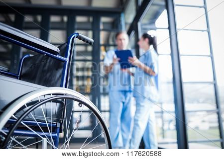 Nurse staff bringing a wheelchair at the hospital