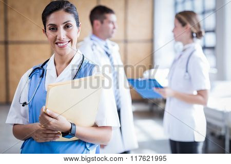 Nurse smiling at the camera in the hospital ward