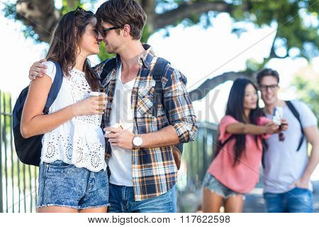 Hip couple about to kiss on the street