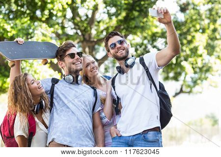 Hip friends taking selfie outdoors