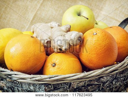 Tin Wicker Basket With Apples, Oranges And Ginger, Closeup