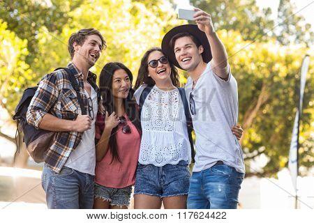 Hip friends taking selfie in the streets