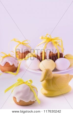 Decorated Easter Cakes And Eggs  In Yellow Colours. Selective Focus.