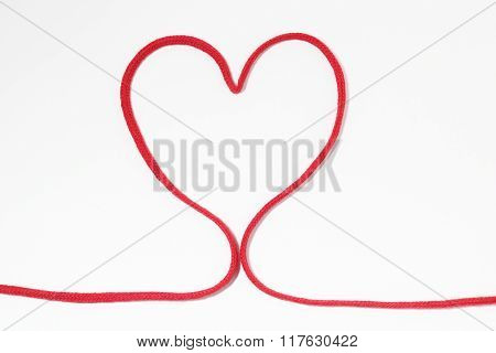 Heart-shaped red string