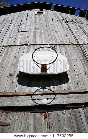 Outdoor basketball on barn siding