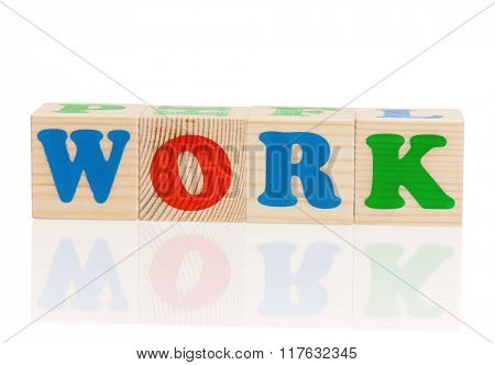 Work word formed by colorful wooden alphabet blocks, isolated on white background