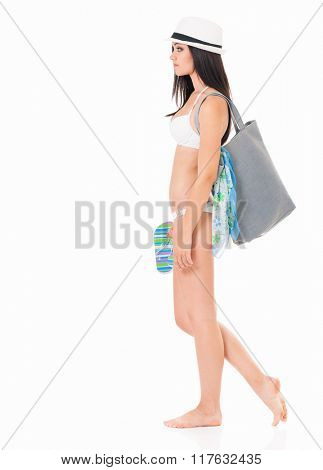 Pretty girl posing in bikini summer hat with bag, isolated on white background