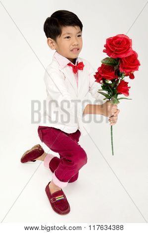 Little Asian Boy In Vintage Suit With Red Rose