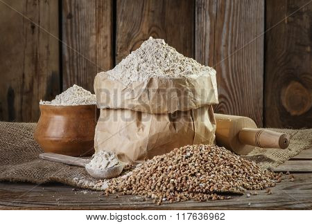buckwheat flour  on the old wooden background closeup