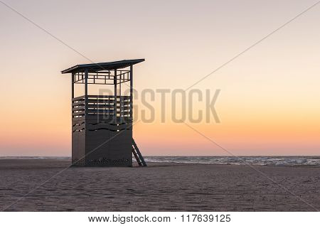 Lifesaver patrol tower on the Coast. Sunset time, summer travel background