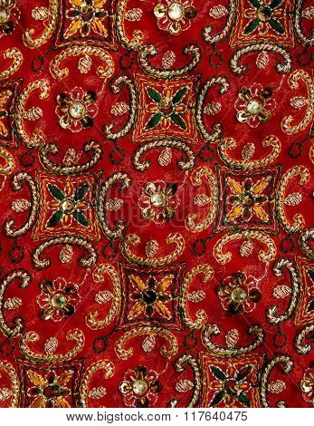 Red sari fabric closeup detail