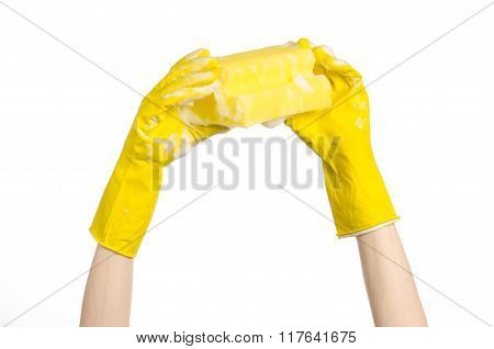 Cleaning The House And Sanitation Topic: Hand Holding A Yellow Sponge Wet With Foam Isolated On A Wh