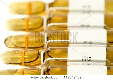 Many Sterile Vial And Ampule Filled With Injection Dosage Form Medication Solution Isolated On White