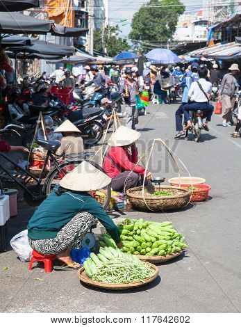 Women are selling greens at the market street
