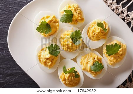 Stuffed Eggs With Mustard And Parsley Close-up. Horizontal Top View