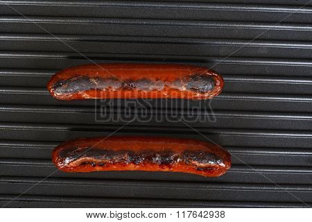 top view sausages cooking on a grill