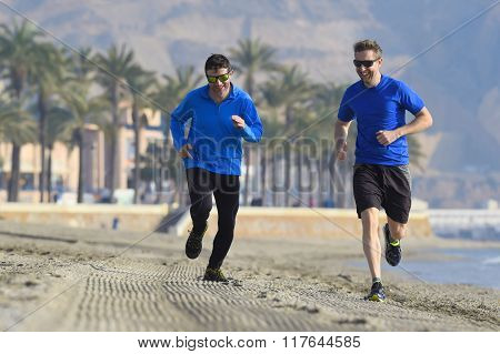 Two Men Friends Running Together On Beach Sand With Palm Trees Morning Training Session Jogging Work