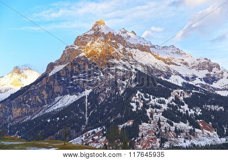 Road view to snow covered mountains in winter Switzerland. Switzerland is a country in Europe. Switzerland has a high mountain range from the Alps to Jura mountains.