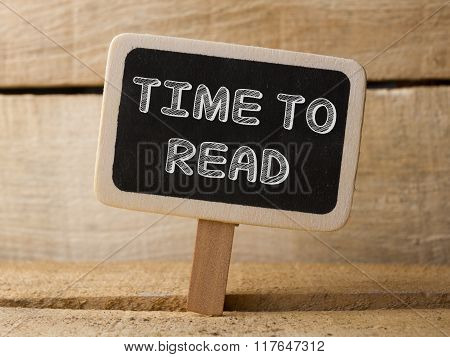 Chalkboard with  word time to Read on wood background