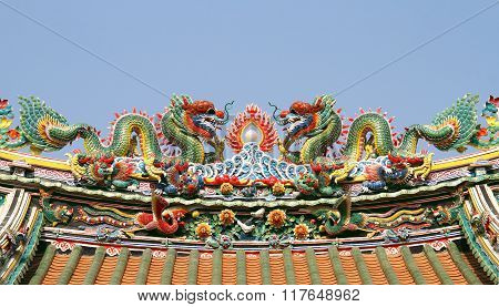 Double Chinese Dragon On The Temple Roof