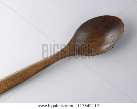 wooden spoon on the white background