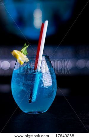 Blue mixed drink with lemon and mint