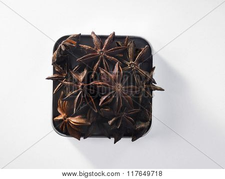 top view of anise star on square container