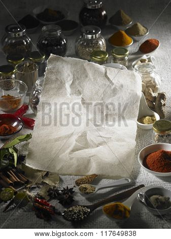 Blank paper with spices in the background.
