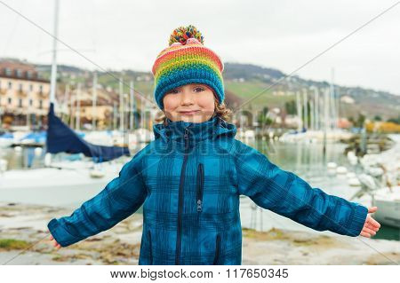 Outdoor close up portrait of a cute little boy of 4-5 years old