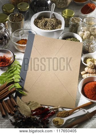 Book with spices on the background.