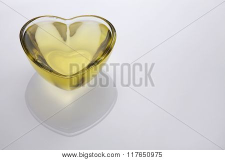 Pouring vegetable cooking oil into a clear glass bowl