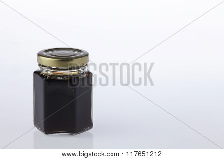 jar of the honey on the white background