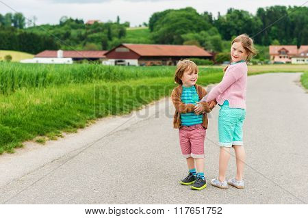 Two cute kids playing in a countryside