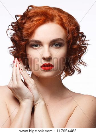 Young beautiful woman with red hair on a white background. Beauty portrait