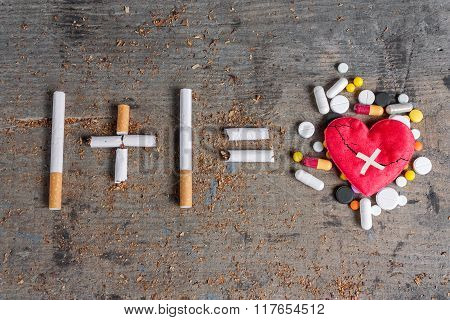 Antismoking background. Diseased heart and pills