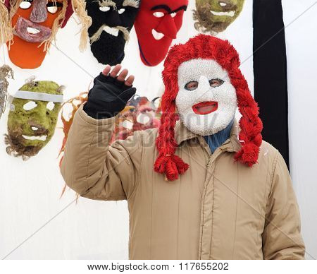 Person in traditional mask selling various goods in flea market on Feb 7, 2016 in Vilnius, Lithuania
