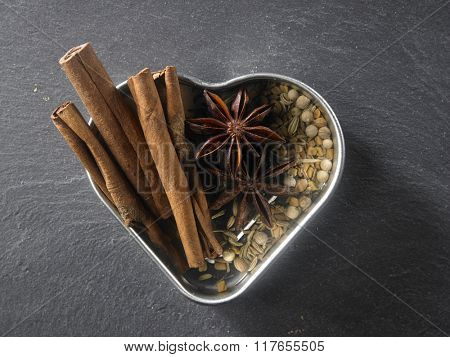 top view of the assorted spices in a heart shape container