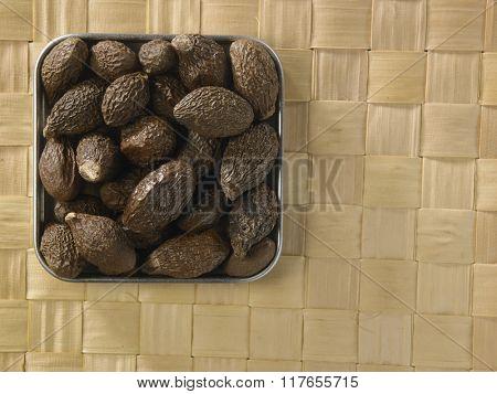 malva nut on the straw checker mat