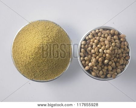 top view of coriander powder and seeds